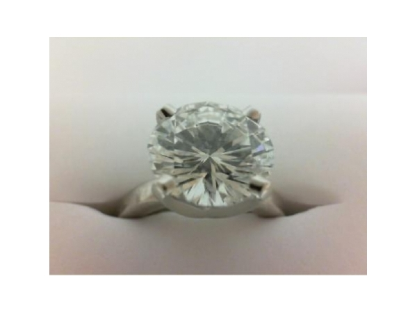 Diamond Engagement Ring - Ladies 14 karat white gold high polished diamond solitaire engagement ring.  This ring features one prong set round brilliant cut diamond.    The diamond is F color, VS2 clarity and weighs 4.01 cts.   This ring is a size 6.50 and weighs 6.30 grams.
