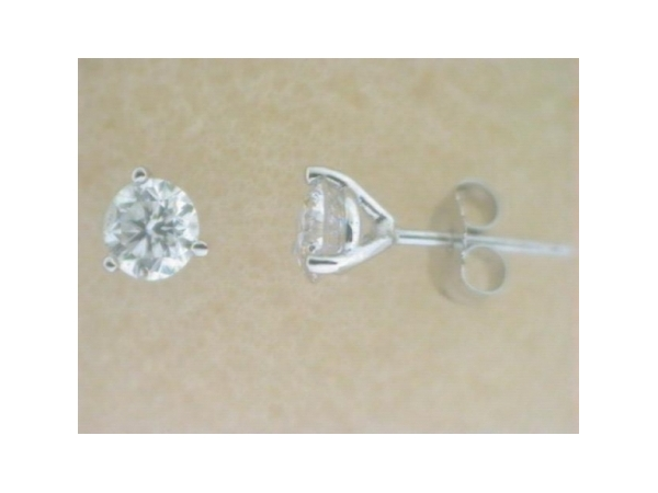 Diamond Stud Earrings - Ladies 14 karat white gold high polished diamond stud earrings.  The earrings feature two martini set round brilliant cut diamonds.  The diamonds are G-H color, I1 clarity and total .075 ct.   The earrings have friction posts and backs and weigh 0.08 gram.