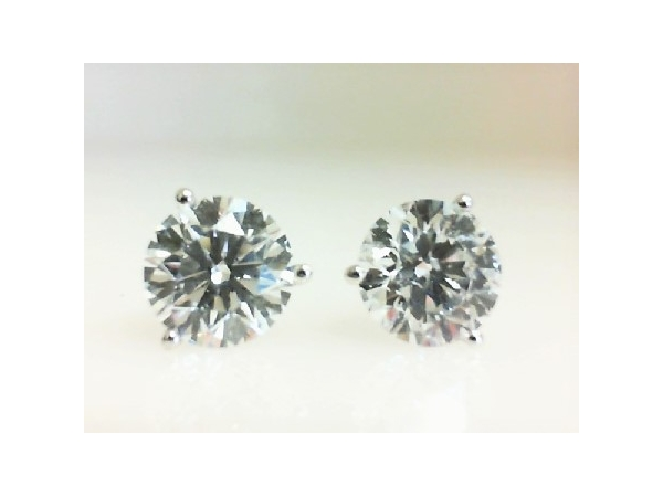Diamond Stud Earrings - Ladies 14 karat white gold high polished diamond stud earrings.  The martini style earrings feature two 3-prong set round diamonds.  The diamonds are D color, SI2 yehuda clarity enhanced and weigh 4.07 cts.  The earrings have friction posts and backs and weigh 1.70 grams.
