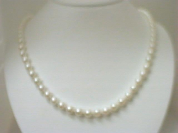 Pearl Necklace - Ladies 14 karat yellow gold pearl necklace.  This necklace features 67 6.50-7.00 mm akoya cultured pearls.  This necklace measures 20.00 inches in length with a filigree clasp.