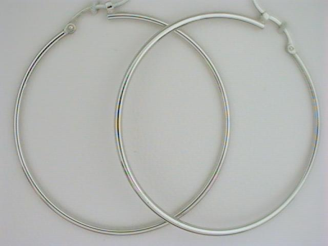 Earrings - Ladies 14 karat white gold high polished large narrow hoop earrings.  The tube hoop earrings measure 40.00 mm in diameter with hinged closure.  The earrings weigh 1.70 grams.