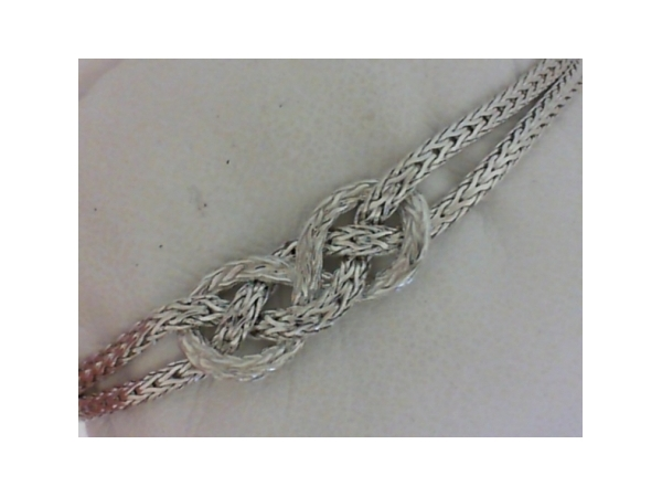 Bracelet - Ladies sterling silver Classic Collection knot station bracelet designed by John Hardy.  This bracelet features a center knot design linked with a braided chain.  This bracelet measures 7.00 inches in length with a lobster claw clasp and weighs 11.00 grams.